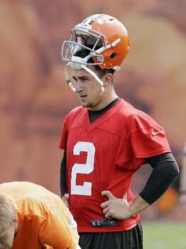 Johnny Manziel waits his turn to run a drill during Browns' OTAs on Wednesday. Photo: Mark Duncan, Associated Press