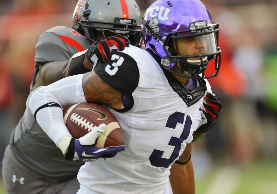 LUBBOCK, TX - SEPTEMBER 12: Brandon Carter #3 of the TCU Horned Frogs is brought down by Dartwan Bush #54 of the Texas Tech Red Raiders  during game action on September 12, 2013 at AT&T Jones Stadium in Lubbock, Texas. Texas Tech won the game 20-10. Photo: John Weast, Getty Images / 2013 John Weast