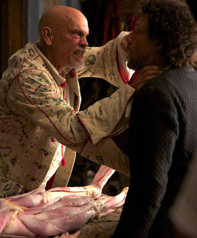 "Blackbeard (John Malkovich) threatens his  captive (Richard Coyle)  in ""Crossbones."" Photo: NBC / 2013 NBCUniversal Media, LLC"