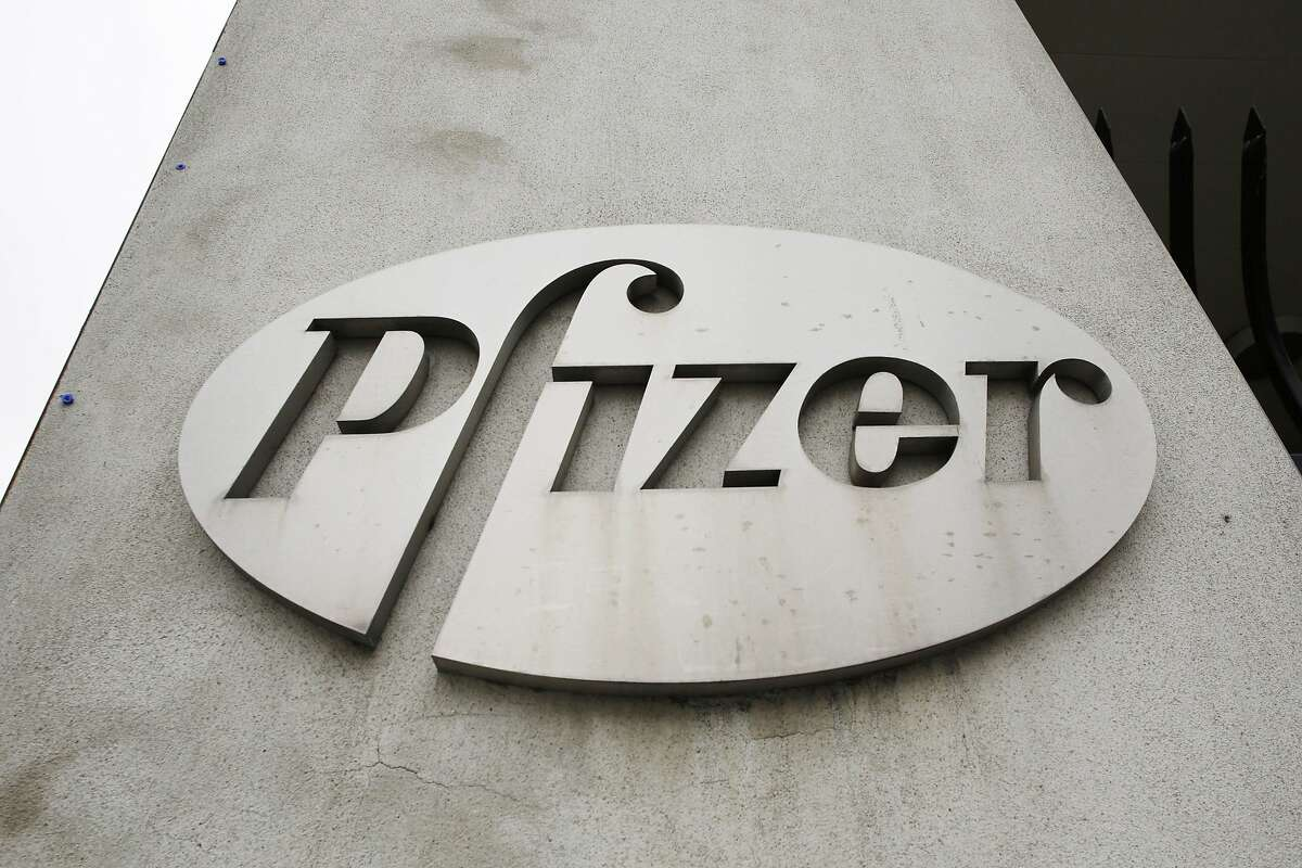 In this May 2014 photo, the Pfizer logo is displayed on the exterior of a former Pfizer factory in Brooklyn.