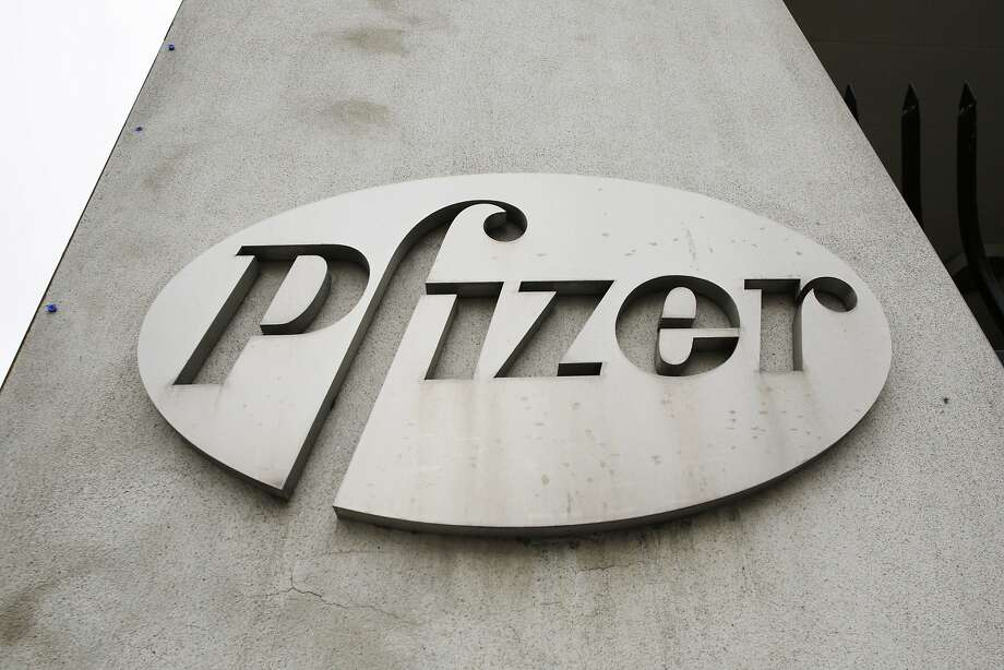 In this May 2014 photo, the Pfizer logo is displayed on the exterior of a former Pfizer factory  in Brooklyn. Photo: Mark Lennihan, Associated Press