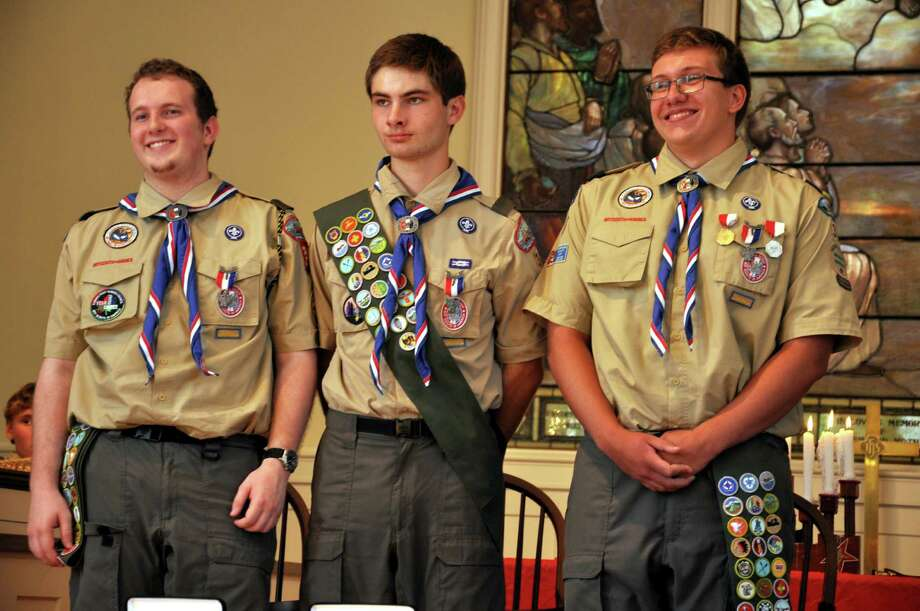 These three Boy Scouts in Westport Troop 39 achieved scouting's highest honor during a ceremony Sunday at Greens Farms Church. Elevated to the rank of Eagle Scout were, from left, Joshua Lindsey-Noble, Ryan Fanning and William Overton. Photo: Picasa, Westport News/Contributed Photo / Westport News