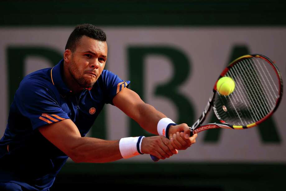 Jo-Wilfried Tsonga of France returns a shot during his men's singles match against  Edouard Roger-Vasselin of France on day one of the French Open at Roland Garros on May 25, 2014 in Paris, France. Photo: Clive Brunskill, Getty Images / 2014 Getty Images