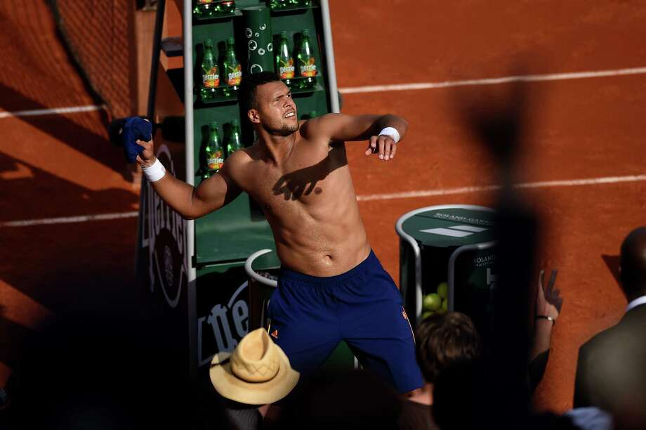 Jo-Wilfried Tsonga of France throws his shirt into the crowd as he celebrates victory in his men's singles match against  Edouard Roger-Vasselin of France on day one of the French Open at Roland Garros on May 25, 2014 in Paris, France. Photo: Matthias Hangst, Getty Images / 2014 Getty Images