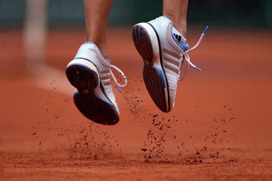 The shoes of Alize Lim of France as she serves during her women's singles match against Serena Williams of the United States of America on day one of the French Open at Roland Garros on May 25, 2014 in Paris, France. Photo: Matthias Hangst, Getty Images / 2014 Getty Images