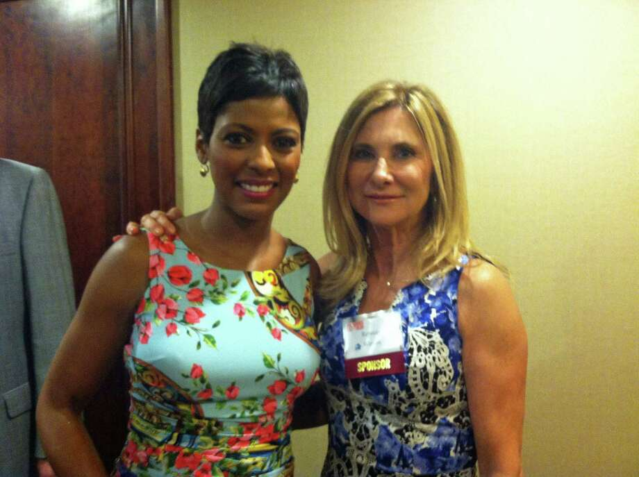 Tamron Hall, a co-host of NBC's TODAY show and host of MSNBC's NewsNation, left, was the keynote speaker and honoree at the Domestic Violence Crisis Center's 12th annual Voices of Courage Spring Luncheon. With her, New Canaan resident Rebecca Watson. Photo: Contributed Photo, Contributed / New Canaan News Contributed