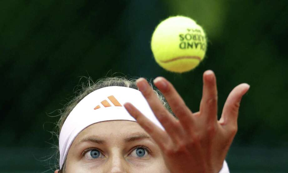 Switzerland's Stefanie Voegele serves to Germanys' Anna-Lena Friedsam during their French tennis Open first round match at the Roland Garros stadium in Paris on May 26, 2014. Photo: KENZO TRIBOUILLARD, AFP/Getty Images / AFP