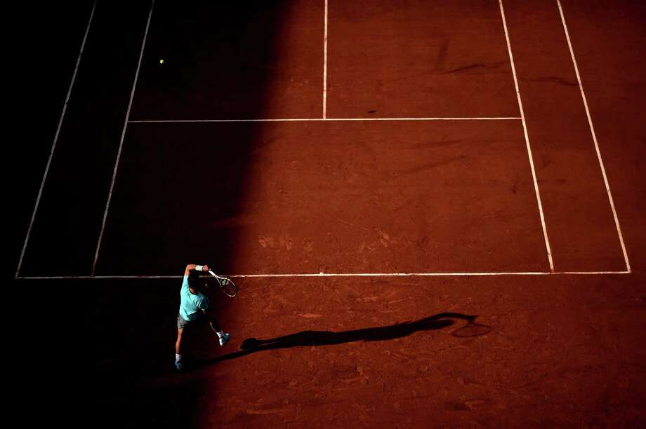 Rafael Nadal of Spain returns a shot during his men's singles match against Robby Ginepri of the United States on day two of the French Open at Roland Garros on May 26, 2014 in Paris, France. Photo: Matthias Hangst, Getty Images / 2014 Getty Images