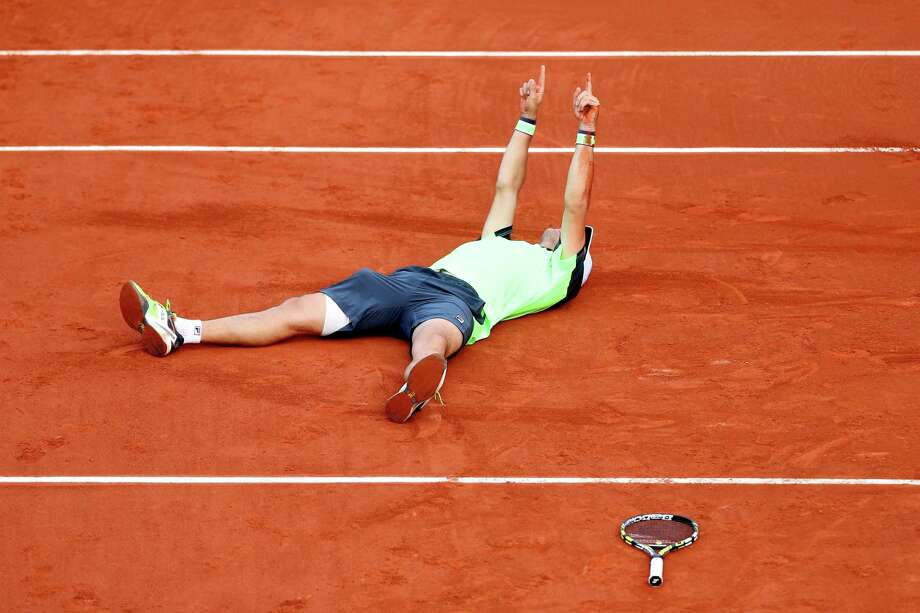 Facundo Bagnis of Argentina celebrates match point in his men's singles match against Julien Benneteau of France on day two of the French Open at Roland Garros on May 26, 2014 in Paris, France. Photo: Matthew Stockman, Getty Images / 2014 Getty Images