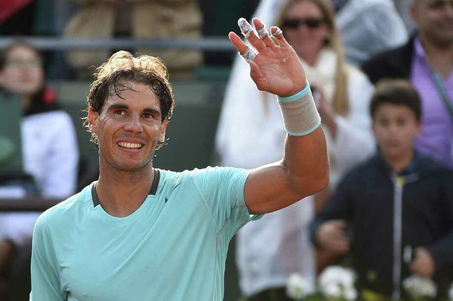 Spain's Rafael Nadal celebrates after winning his French tennis Open first round match against USA's Robby Ginepri at the Roland Garros stadium in Paris on May 26, 2014. Photo: PASCAL GUYOT, AFP/Getty Images / AFP