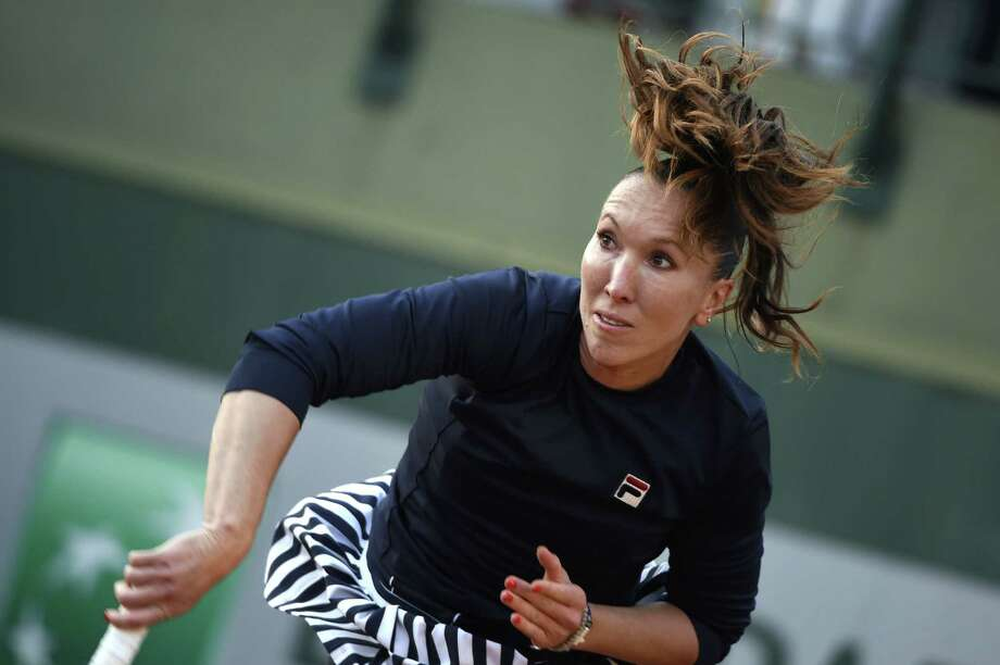 Serbia's Jelena Jankovic  serves to Canada's Sharon Fichman during their French tennis Open first round match at the Roland Garros stadium in Paris on May 26, 2014. Photo: DOMINIQUE FAGET, AFP/Getty Images / AFP