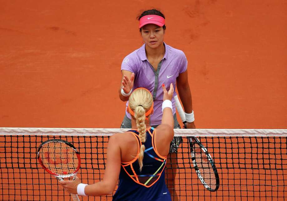 Na Li of China shakes hands at the net with Kristina Mladenovic of France after her defeat in the women's singles match on day three of the French Open at Roland Garros on May 27, 2014 in Paris, France. Photo: Clive Brunskill, Getty Images / 2014 Getty Images