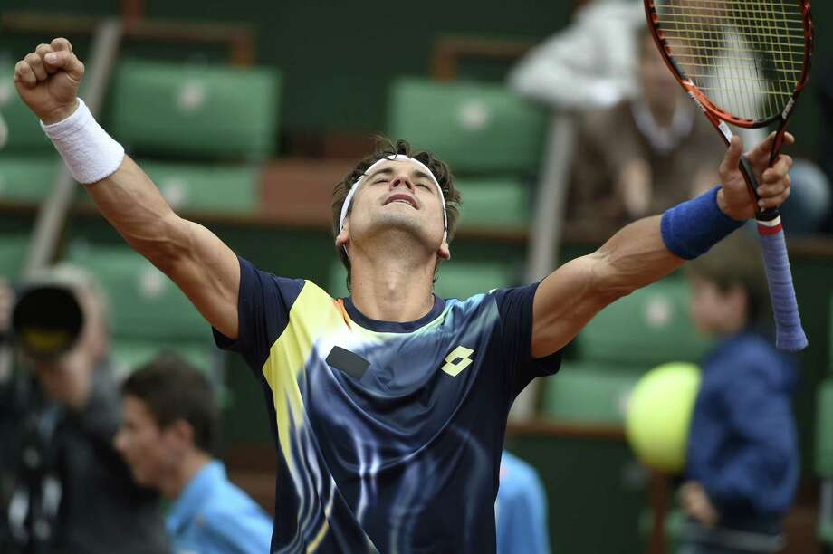 Spain's David Ferrer celebrates his victory over Netherland's Igor Sijsling at the end of their French tennis Open first round match at the Roland Garros stadium in Paris on May 27, 2014. Photo: DOMINIQUE FAGET, AFP/Getty Images / AFP