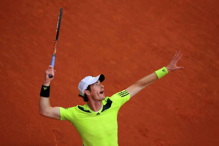 Andy Murray of Great Britain serves during his men's singles match against Andrey Golubev of Kazakhstan on day three of the French Open at Roland Garros on May 27, 2014 in Paris, France. Photo: Clive Brunskill, Getty Images / 2014 Getty Images