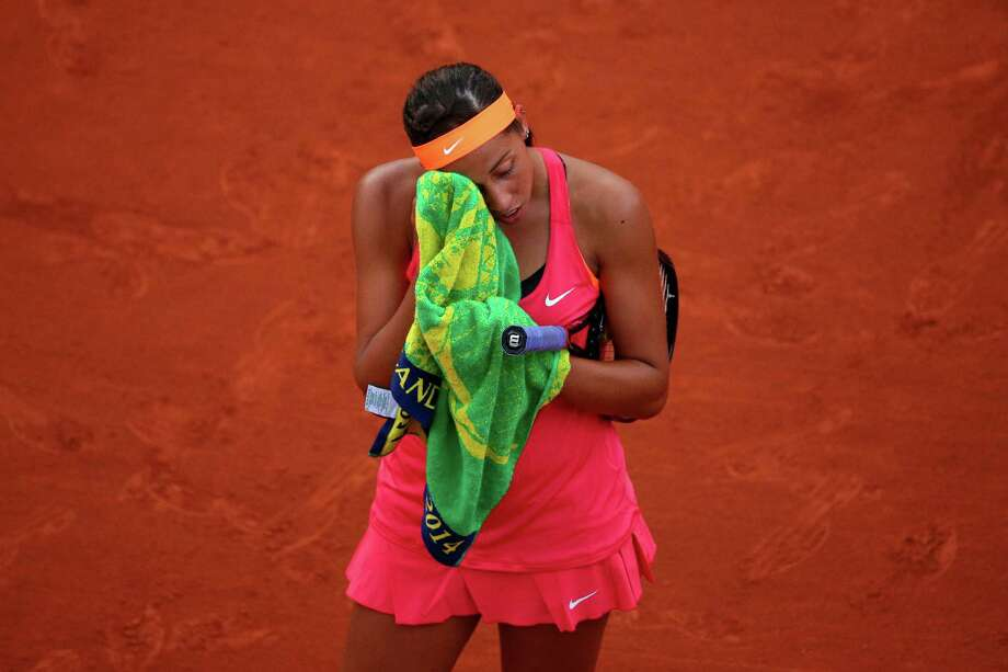 Madison Keys of the United States reacts during her women's singles match against Sara Errani of Italy on day three of the French Open at Roland Garros on May 27, 2014 in Paris, France. Photo: Clive Brunskill, Getty Images / 2014 Getty Images