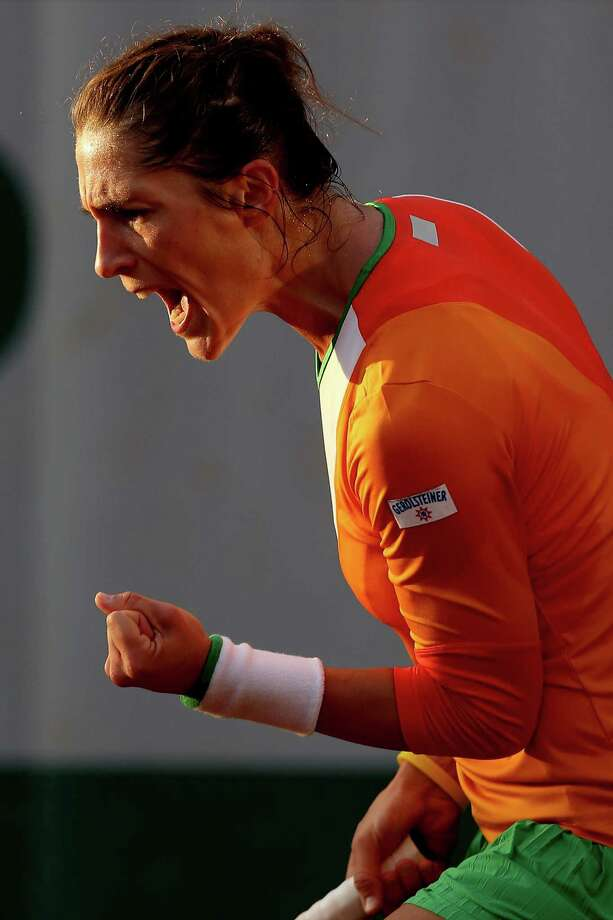 Andrea Petkovic of Germany celebrates match point in her women's singles match against Misaki Doi of Japan on day two of the French Open at Roland Garros on May 26, 2014 in Paris, France. Photo: Matthew Stockman, Getty Images / 2014 Getty Images