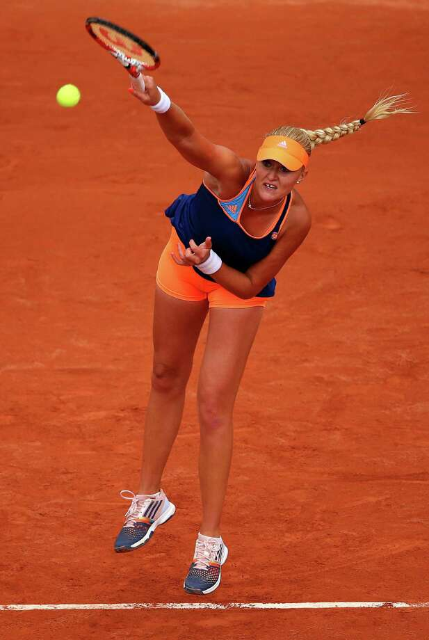Kristina Mladenovic of France serves during her women's singles match against Na Li of China on day three of the French Open at Roland Garros on May 27, 2014 in Paris, France. Photo: Clive Brunskill, Getty Images / 2014 Getty Images