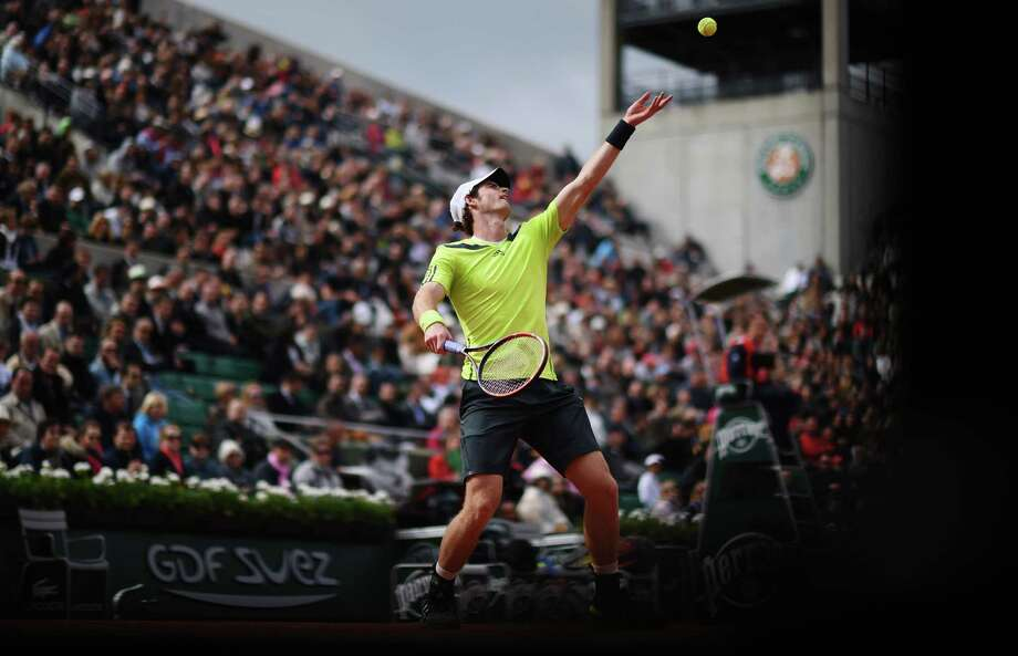 Andy Murray of Great Britain serves during his men's singles match against Andrey Golubev of Kazakhstan on day three of the French Open at Roland Garros on May 27, 2014 in Paris, France. Photo: Matthias Hangst, Getty Images / 2014 Getty Images