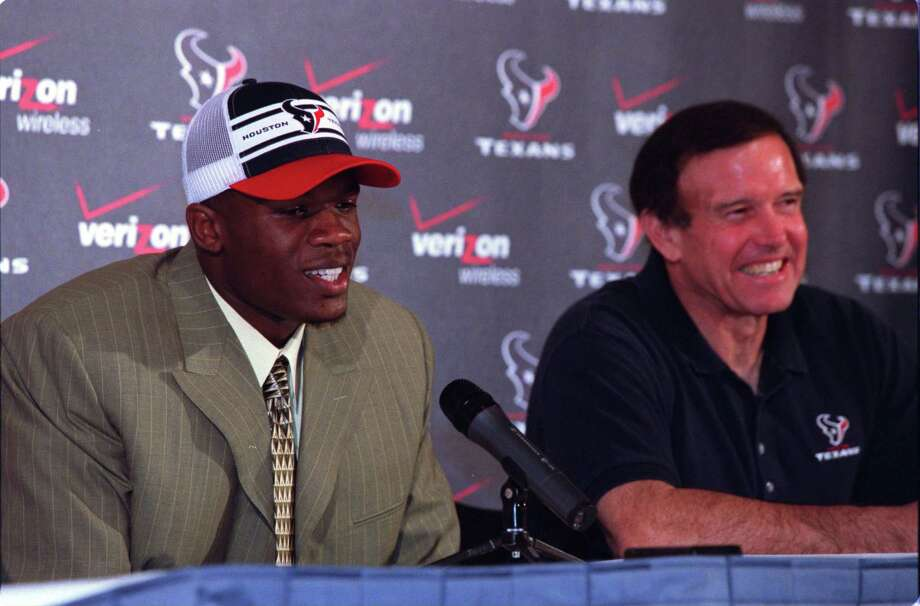 Houston Texans welcome their first pick in the NFL draft Andre Johnson, a wide receiver from the University of Miami, while head coach Dom Capers enjoys his new prospect Saturday night, April 26, 2003, at Reliant Stadium in Houston. Photo: Kevin Fujii, Houston Chronicle
