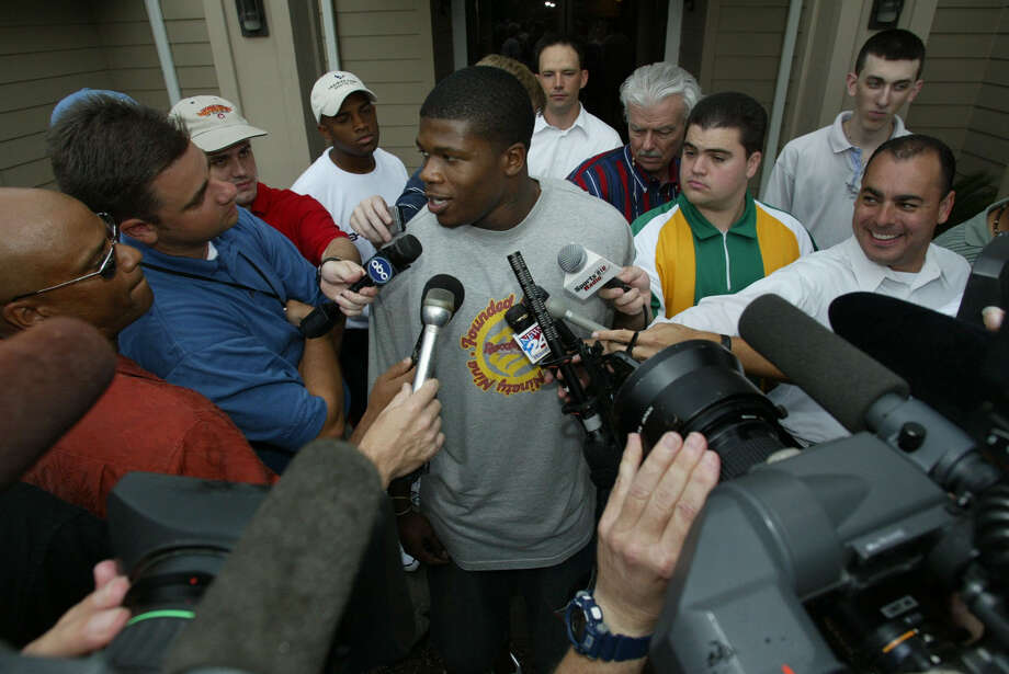 Houston Texans first-round draft pick Andre Johnson answers questions after arriving at the team hotel Thursday, July 24, 2003, in Houston. Photo: KEVIN FUJII, Houston Chronicle