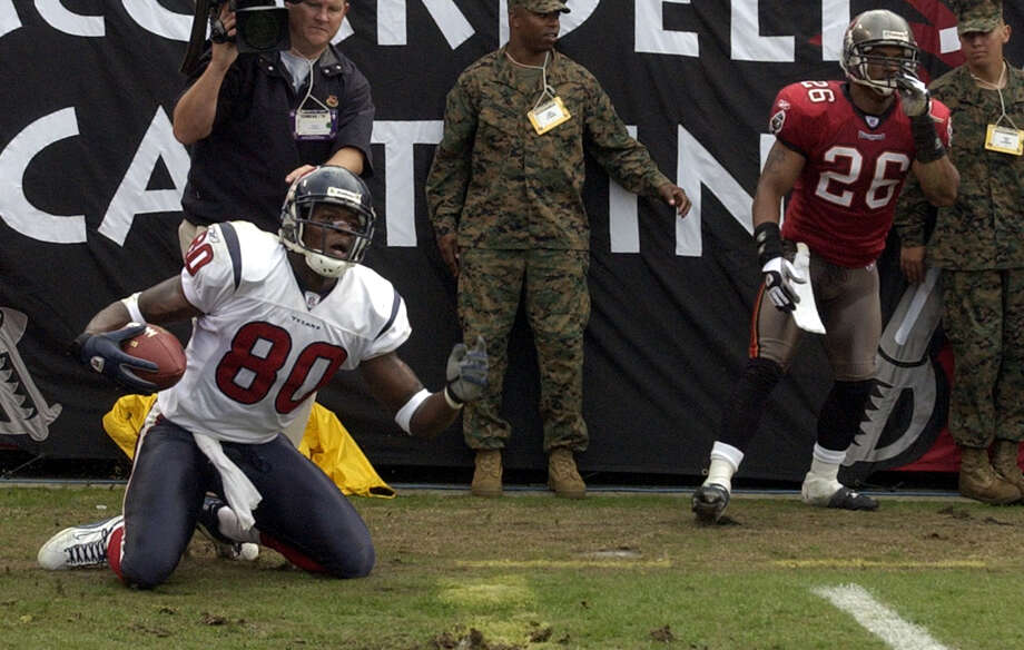 Texans wide reciever Andre Johnson pleads with the linesman after catching what would have been a Texans touchdown in front of Tampa Bay corner Dwight Smith. Photo: Karl Stolleis, Houston Chronicle