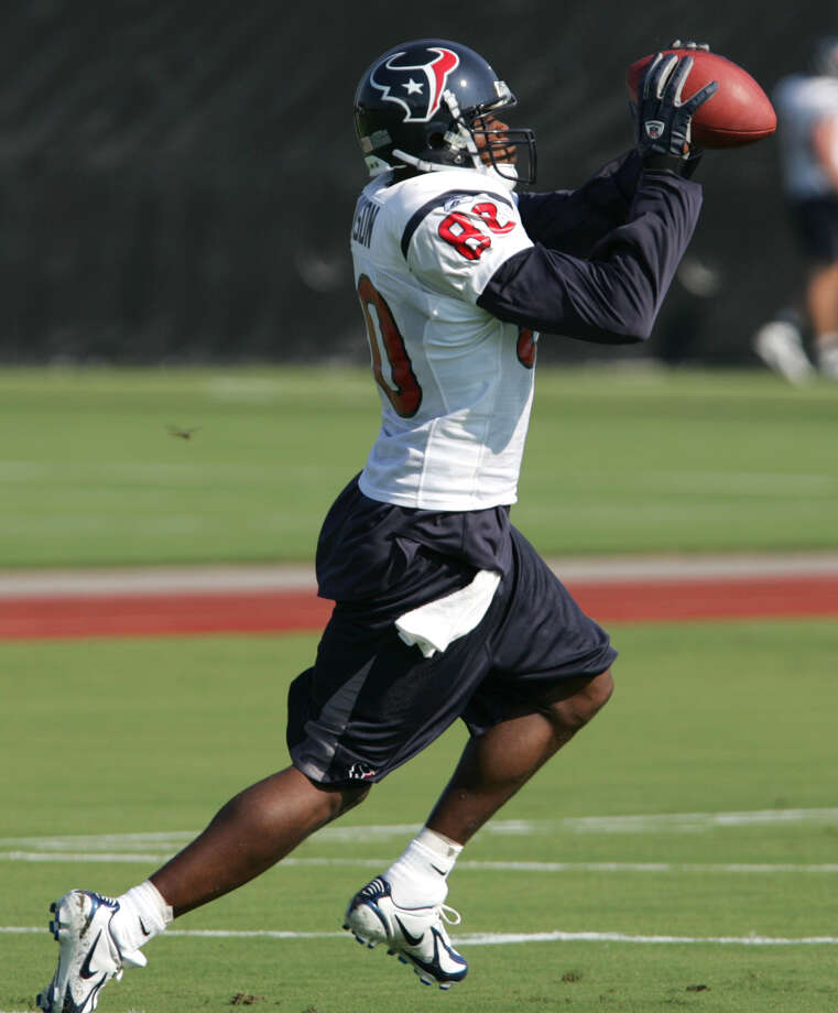 Houston Texans receiver Andre Johnson catches a pass during the opening practice of Houston Texans training camp Saturday, July 30, 2005, at Reliant Park in Houston. Photo: BRETT COOMER, Houston Chronicle