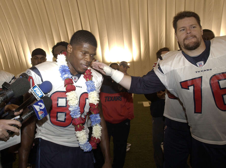 Andre Johnson is congratulated by lineman Steve McKinney after the team was informed that Johnson was named to the Pro Bowl on Dec. 22, 2004. Johnson was informed after the Texans' practice that he had been named to the all star team. He was given a Hawaiian Lei when he was told because the Pro Bowl is held in Hawaii. Photo: Steve Campbell, Houston Chronicle