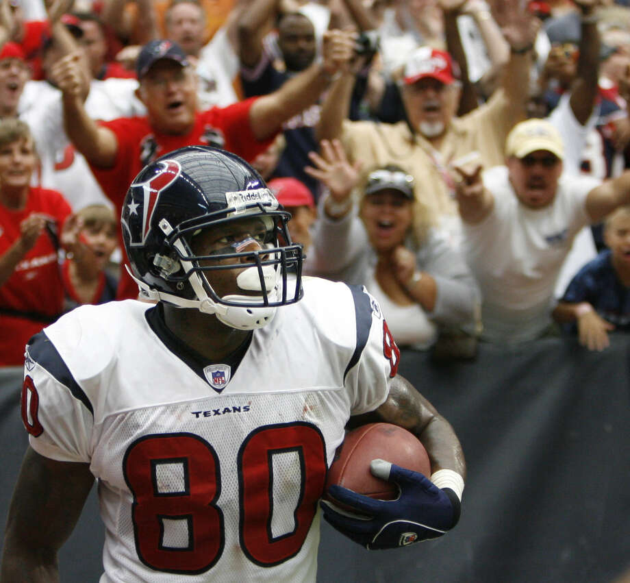 Houston Texans fans celebrate wide receiver Andre Johnson three-yard touchdown reception against the Miami Dolphins in the fourth quarter Sunday, Oct. 1, 2006, at Reliant Stadium in Houston.  Texans won 17-15. Photo: Kevin Fujii, Houston Chronicle