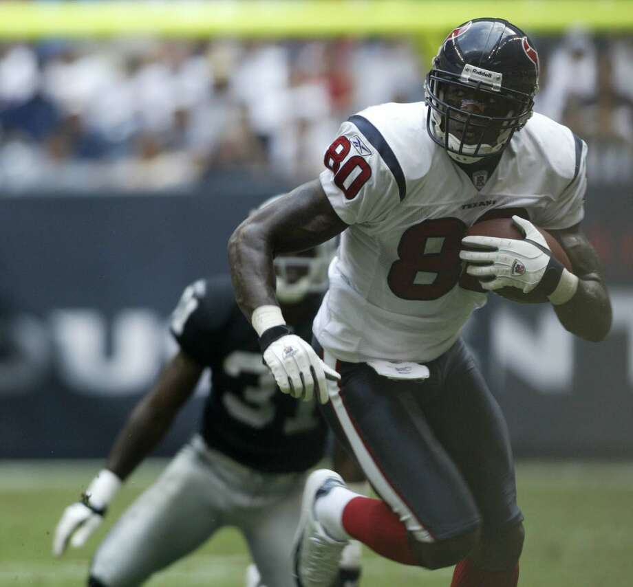 Andre Johnson gains yardage after a quick out pattern in the fourth quarter of an NFL preseason game between the Houston Texans and the Oakland Raiders at Reliant Stadium in Houston, 10/03/04. Photo: Buster Dean, Houston Chronicle