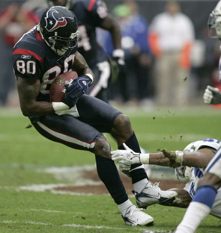 Houston Texans receiver Andre Johnson falls away from Indianapolis Colts defender Antoine Bethea for a 17-yard reception and a first down during the fourth quarter Sunday, Dec. 24, 2006, at Reliant Stadium in Houston.  The Texans upset the Colts 27-24 with a 48-yard Kris Brown field goal with three seconds left. Photo: BRETT COOMER, HOUSTON CHRONICLE / Houston Chronicle
