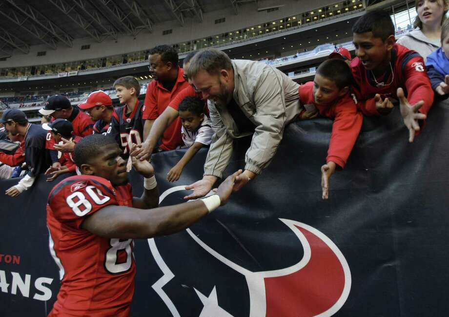 Houston Texans wide receiver Andre Johnson (80) high fives fans as he walks off the field following the Texans win over the Jacksonville Jaguars in an NFL football game at Reliant Stadium Sunday, Dec. 30, 2007, in Houston. The Texans beat the Jaguars 42-28, to finish the season a team franchise best record of 8-8. Photo: Brett Coomer, Houston Chronicle / © 2007 Houston Chronicle