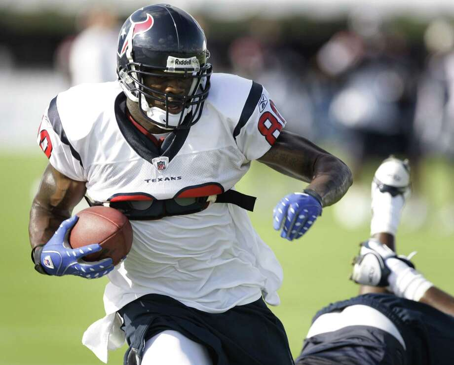 Houston Texans wide receiver Andre Johnson (80) runs past Texans cornerback Fred Bennett (32) after making a catch during Texans training camp Wednesday, July 30, 2008, in Houston. Photo: Brett Coomer, Houston Chronicle / © 2008 Houston Chronicle