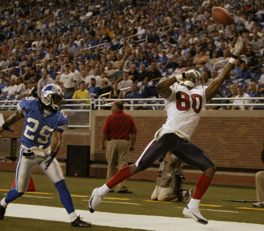 Houston Texans wide receiver Andre Johnson reaches for an overthrown fourth-quarter pass in the endzone over Detroit Lions corner back Chris Cash at Ford Field Sunday afternoon, Sept. 19, 2004, in Detroit, Mich. Photo: Kevin Fujii, Houston Chronicle