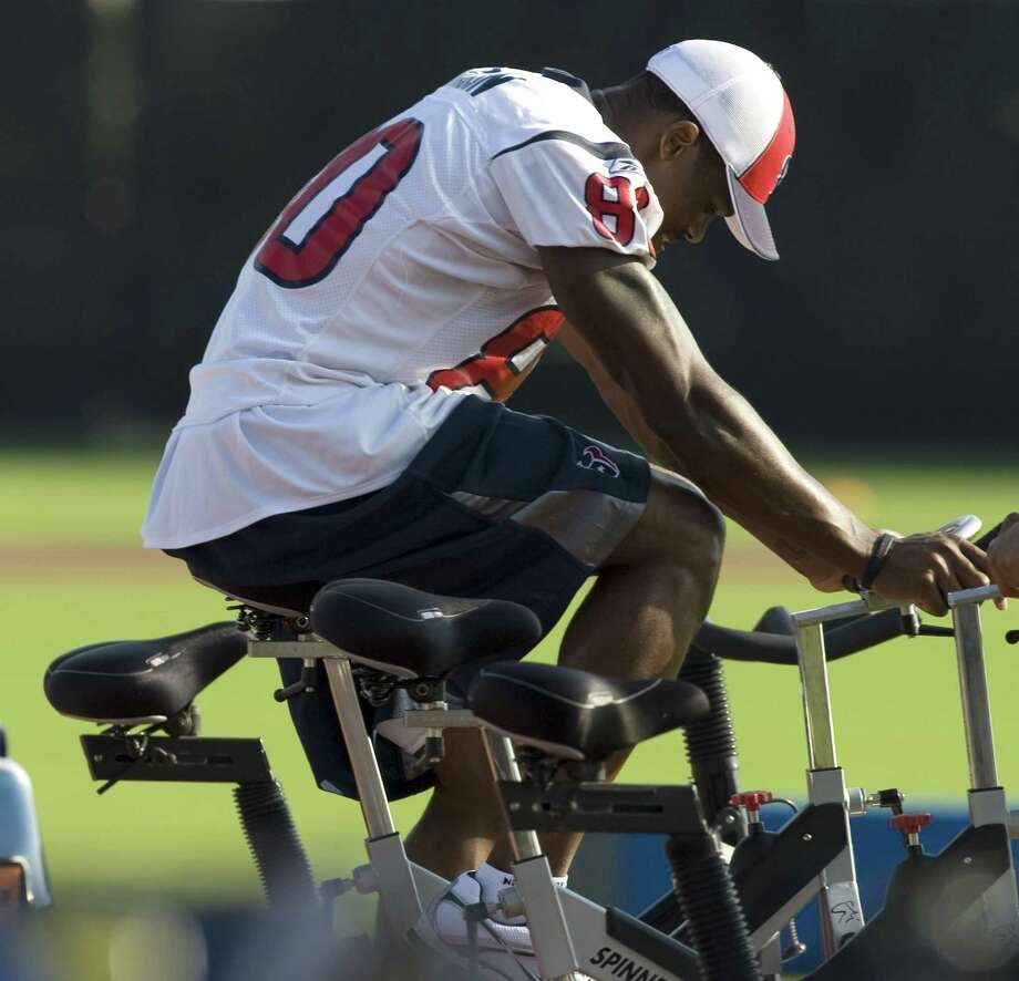 Houston Texans wide receiver Andre Johnson (80) rides a stationary bicycle at practice during Texans training camp Monday, Aug. 4, 2008, in Houston. Johnson sat out Monday's practice after suffering an injury during practice on Saturday. Photo: Brett Coomer, Houston Chronicle / © 2008 Houston Chronicle