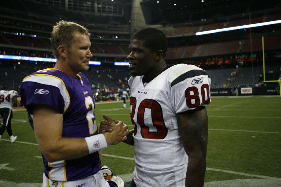 Minnesota Vikings quarterback Sage Rosenfels (2), left, says good bye to Houston Texans wide receiver Andre Johnson (80) after his game Monday, Aug. 31, 2009, at Reliant Stadium in Houston. The Vikings  won the game by a score of 17-10. Photo: Nick De La Torre, Houston Chronicle