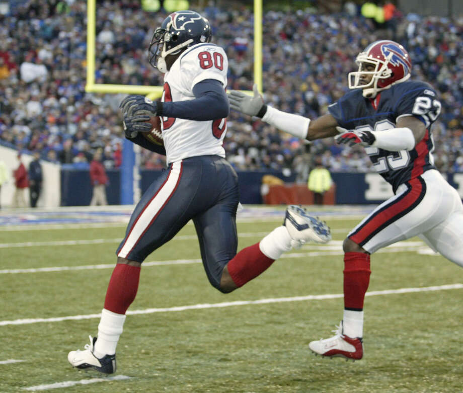 Houston Texans wide receiver Andre Johnson races Buffalo Bills safety Pierson Prioleau to the end zone during the fourth quarter Sunday afternoon, Nov. 16, 2003, at Ralph Wilson Stadium in Orchard Park, NY.  Prioleau pushed Johnson out of bounds.  But the Texans went on to defeat the Bills 12-10. Photo: Kevin Fujii, Houston Chronicle