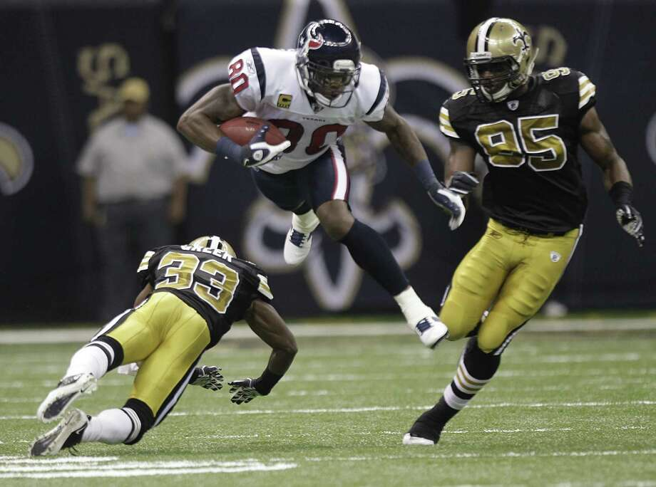 Houston Texans wide receiver Andre Johnson (80) leaps over New Orleans Saints cornerback Jabari Greer (33) during the first quarter of an NFL football game at the Louisiana Superdome Sunday, Sept. 25, 2011, New Orleans. The Saints beat the Texans 40-33. Photo: Brett Coomer, Houston Chronicle / © 2011 Houston Chronicle