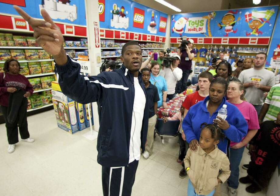 Texans wide receiver Andre Johnson tells 11 kids, selected by Child Protective Services, they have 80 seconds to get all the toys he can and that he was going to pay for them Tuesday, Dec. 13, 2011, in Toys R' Us in Houston. After the spree Johnson, who also bought a video game system with two games, payed $17,260.57. Photo: Nick De La Torre, Houston Chronicle / © 2011  Houston Chronicle