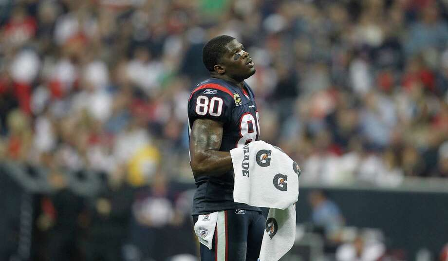 Texans wide receiver Andre Johnson (80) glances up during a timeout during the first quarter of a game against the Falcons on Dec. 4. Photo: Karen Warren, Houston Chronicle / © 2011 Houston Chronicle