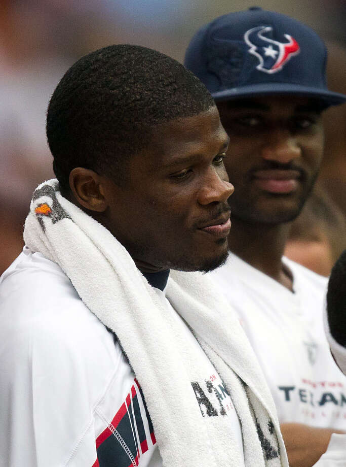 Texans wide receiver Andre Johnson watches from the sidelines against the Cleveland Browns during the second quarter of an NFL football game at Reliant Stadium on Sunday, Nov. 6, 2011, in Houston. ( Smiley N. Pool / Houston Chronicle ) Photo: Smiley N. Pool, Houston Chronicle / © 2011  Houston Chronicle