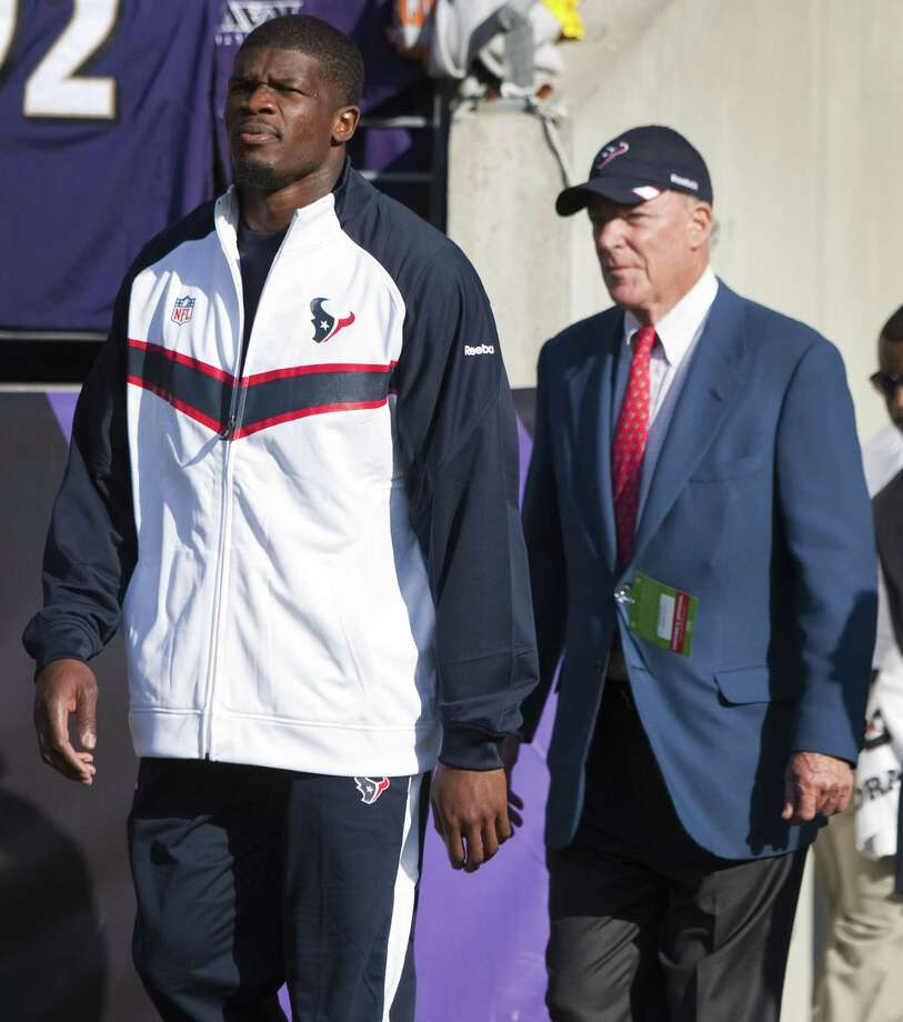 Texans wide receiver Andre Johnson, left, walks onto the field in street clothes followed by Texans owner Bob McNair before and an NFL football game between the Texans and the Baltimore Ravens at M&T Bank Stadium Sunday, Oct. 16, 2011, in Baltimore. Johnson did not play against the Ravens because of a hamstring injury. Photo: Brett Coomer, Houston Chronicle / © 2011  Houston Chronicle