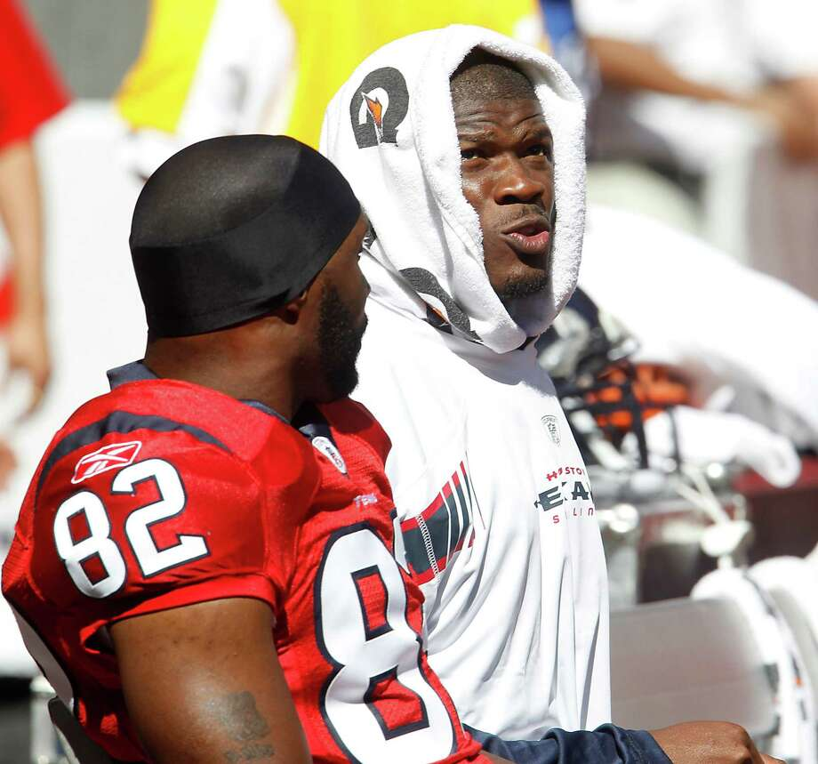 Houston Texans wide receiver Andre Johnson (80) sits on the sideline with wide receiver Derrick Mason (82) in the second quarter of an NFL football game at Reliant Stadium, Oct. 30, 2011. Photo: Karen Warren, Houston Chronicle / © 2011 Houston Chronicle