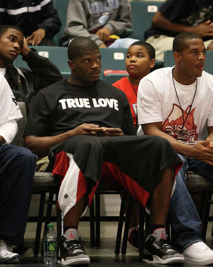 Andre Johnson sits on the front row during the second half of the Travis-Yates High School boys season opening basketball game at the Merrell Center in Katy, Nov. 14, 2011. Travis won the game against Yates 69-77. ( Karen Warren / Houston Chronicle Photo: Karen Warren, Houston Chronicle / © 2011 Houston Chronicle