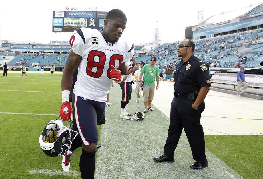 Texans wide receiver Andre Johnson (80) comes off the field after the Texans' win against Jacksonville Jaguars during an NFL football game at EverBank Field in Jacksonville, Fla, Nov. 27, 2011. Photo: Karen Warren, Houston Chronicle / © 2011 Houston Chronicle