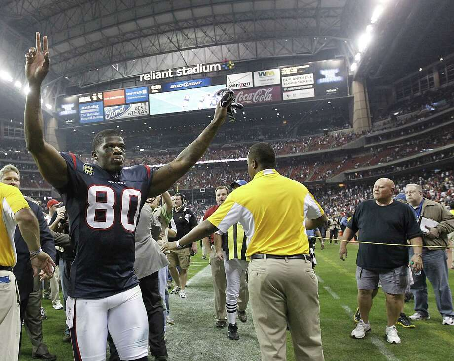 Texans wide receiver Andre Johnson (80) reacts as he walks into the tunnel after an AFC wildcard playoff football game at Reliant Stadium on Saturday, Jan. 7, 2012, in Houston. Photo: Karen Warren, Houston Chronicle / © 2012  Houston Chronicle