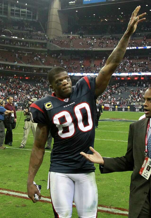 Houston Texans wide receiver Andre Johnson (80) waves to the crowd as he walks off the field after beating the Cincinnati Bengals in an AFC wildcard playoff football game Jan. 7 at Reliant Stadium. Photo: Nick De La Torre, Houston Chronicle / © 2012  Houston Chronicle