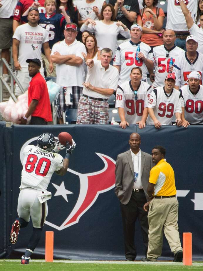 Andre Johnson catches a touchdown pass during the Texans win over the Dolphins on Sept. 9, 2012. Photo: Smiley N. Pool, Houston Chronicle