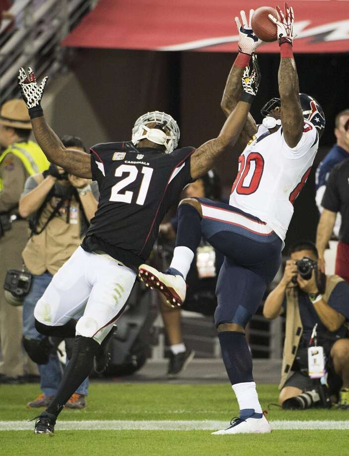 Andre Johnson catches a 5-yard touchdown pass from Case Keenum as Cardinals cornerback Patrick Peterson defends during the Texans' loss on Nov. 10, 2013 Photo: Smiley N. Pool, Houston Chronicle