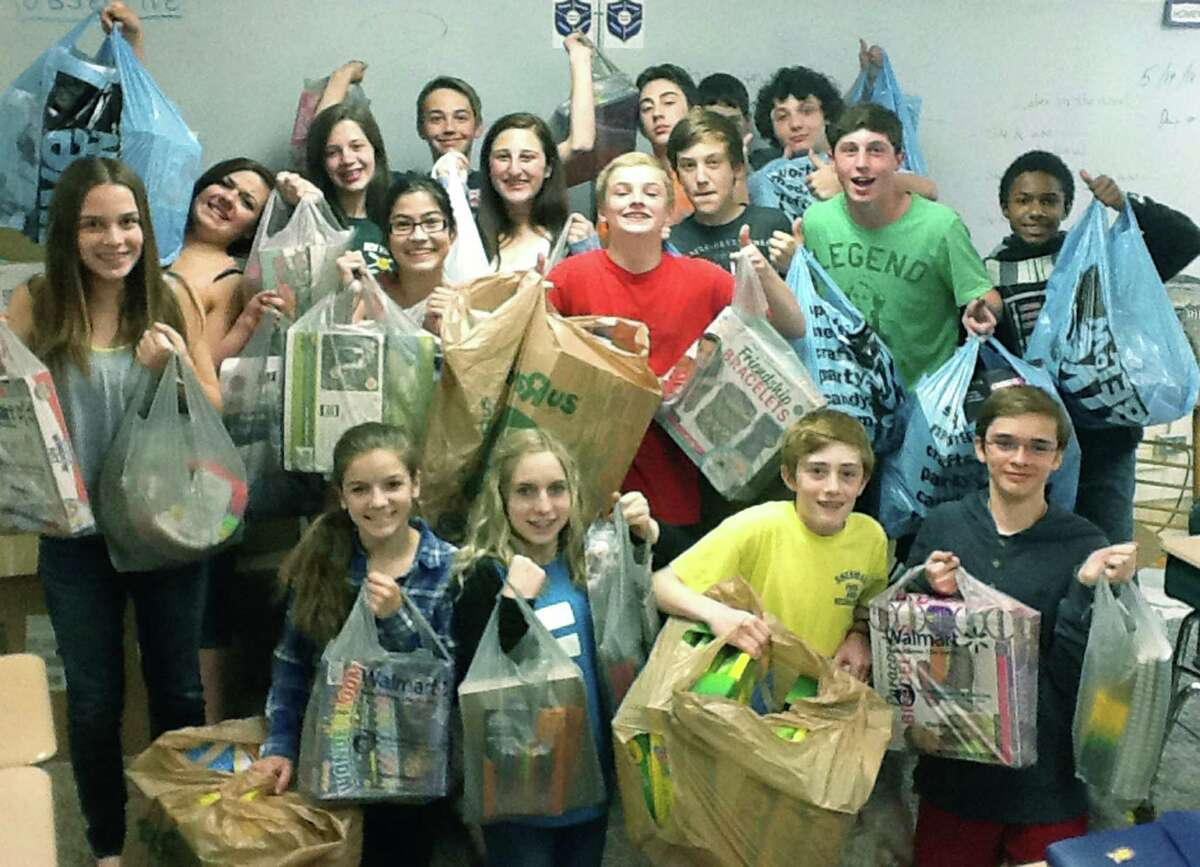 Eighth-grade students at Sherman School display some of the donations they've collected in memory of classmate Julia Malsin, who lost her battle with aplastic anemia. May 2014 Courtesy of Sherman School