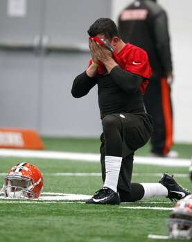 BEREA, OH - MAY 17:  Cleveland Browns draft pick Johnny Manziel #2  dries his face on his jersey  during the Cleveland Browns rookie minicamp on May 17, 2014 at the Browns training  facility in Berea, Ohio.  (Photo by David Maxwell/Getty Images) Photo: David Maxwell, Getty Images